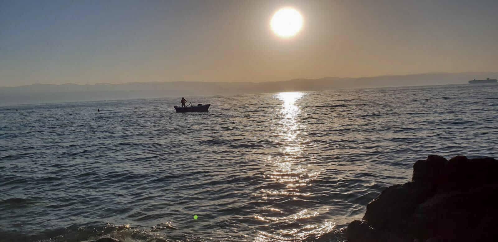 Sonnenuntergang mit Fischer